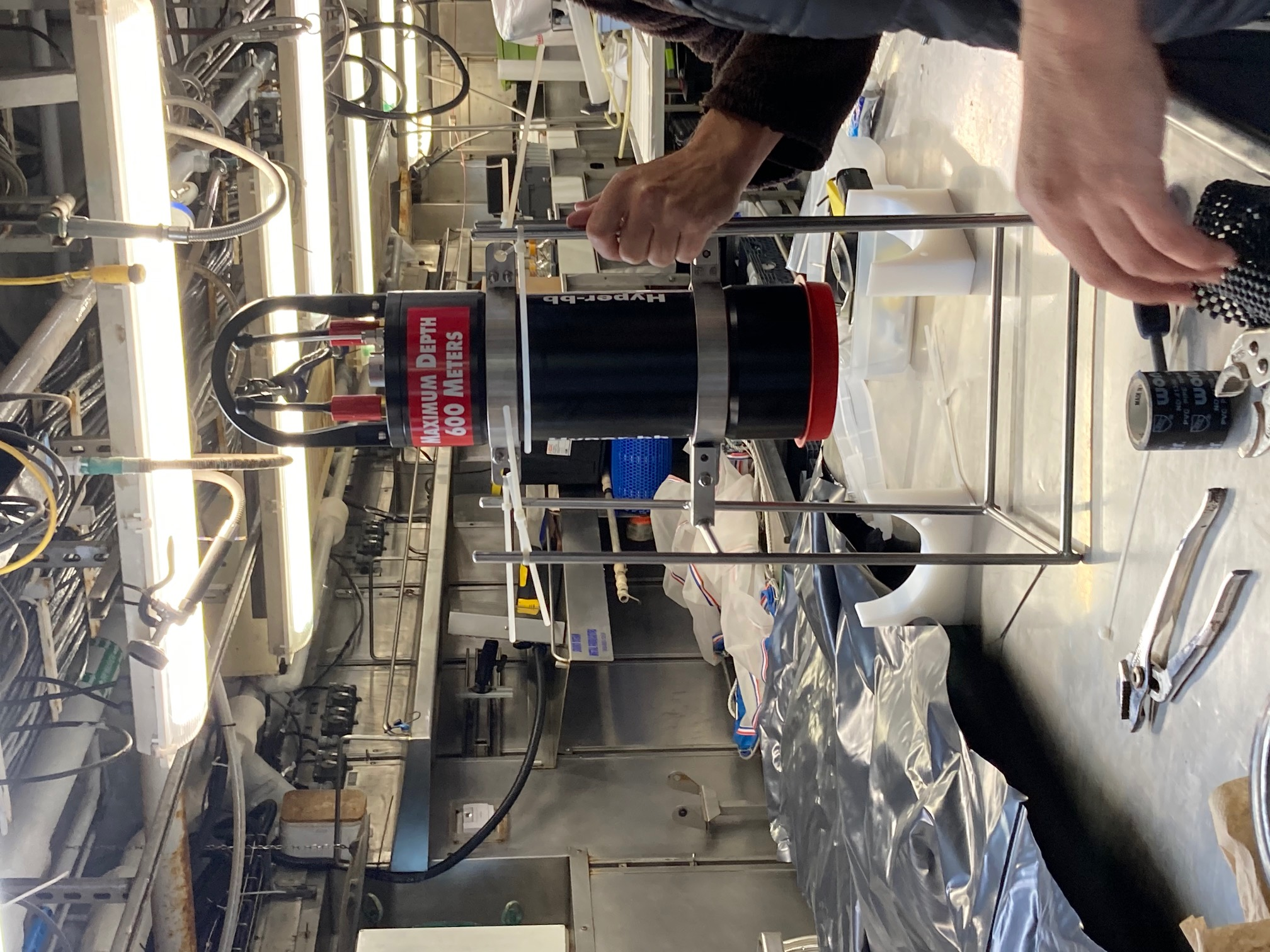 Fabricating a cage for the Hyper-bb, an instrument designed to measure spectral backscattering.