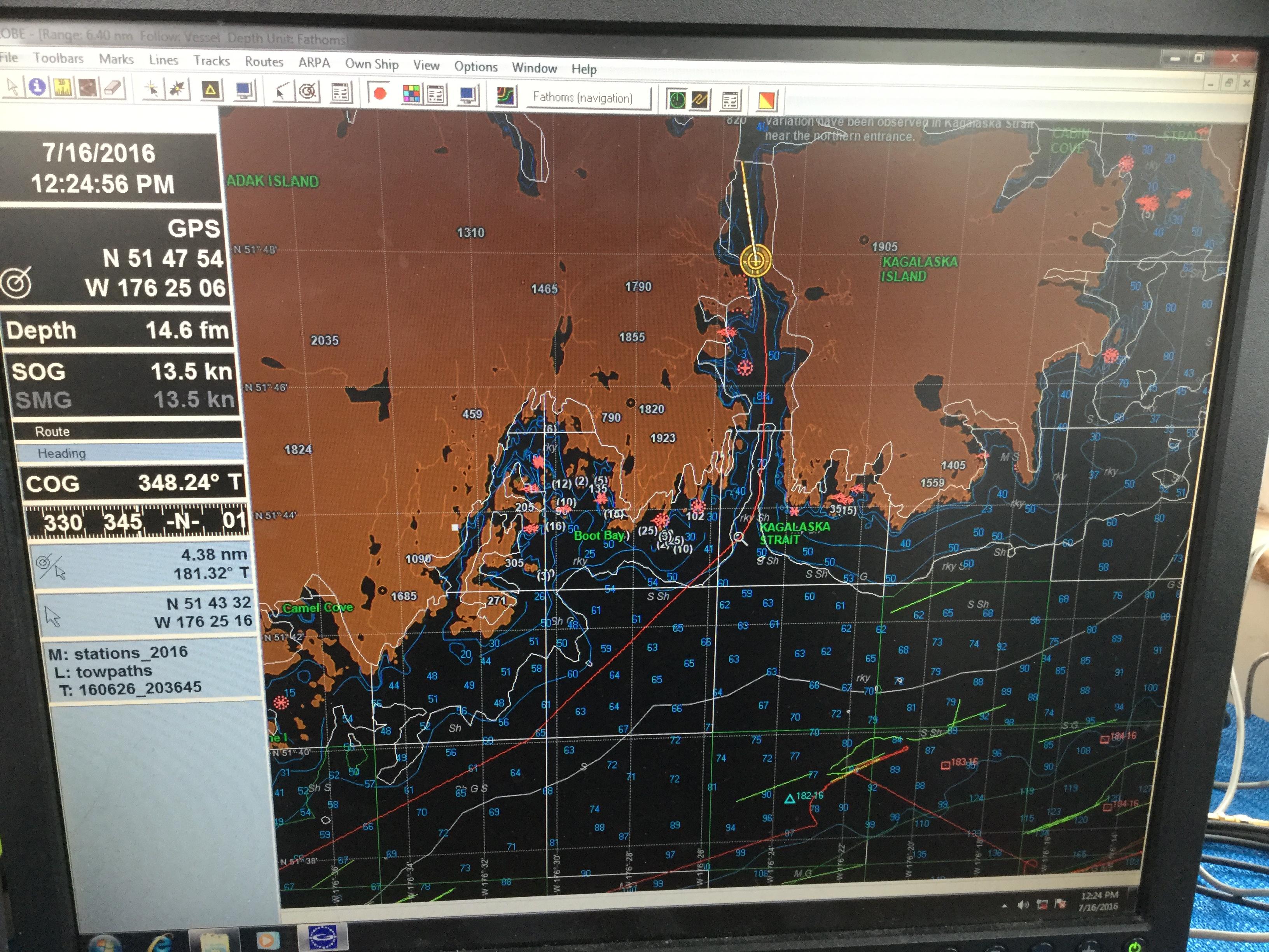 Photo of a laptop monitor navigational map display of the Kagalaska Strait.