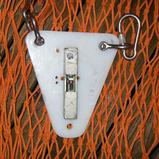 Photo of a light sensor tag attached to a net.