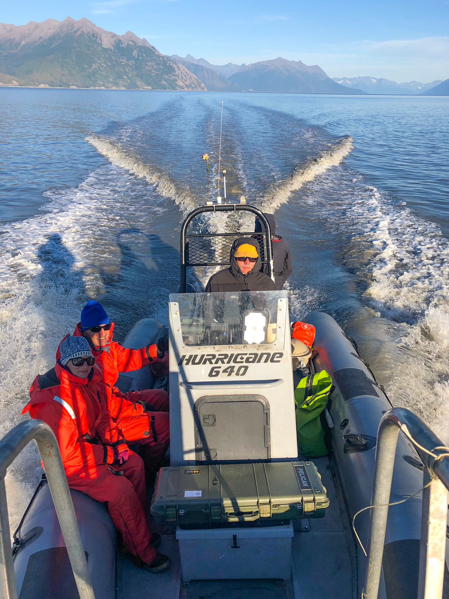 Photo of NOAA Fisheries researchers in a small boat, in Cook Inlet, Alaska.