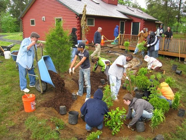 Group of people outdoors landscaping