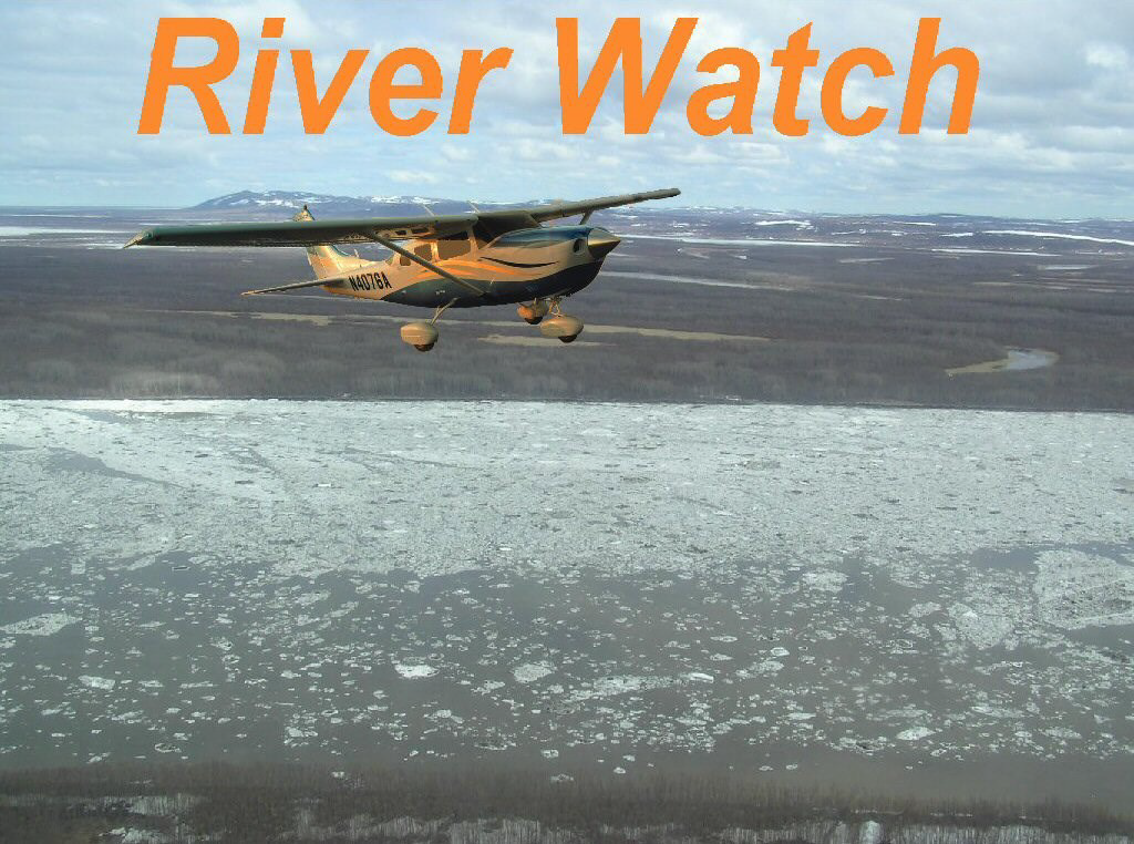 Plane flying above a river with ice during breakup