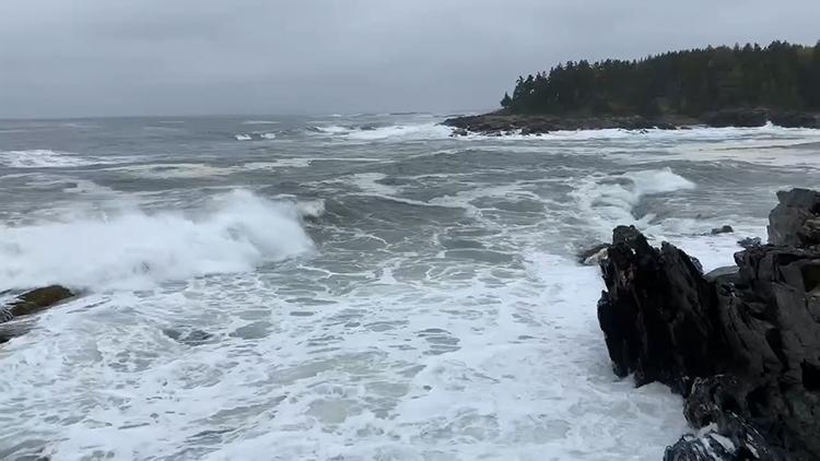 Surf crashing on rocks.