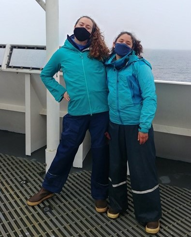 Dawn and Rachel in matching, many-layered outfits, 125 miles offshore on the flying bridge of the RV Bell M. Shimada.