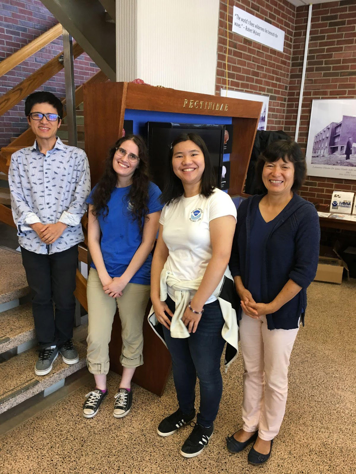 Judy Li (right to left) standing with her mentees Yuyuan Xie (NRC postdoc), Anna Ryack (Mount Holyoke College summer intern) and Rachel So (NOAA Hollings scholar) in the lobby of  the Milford Laboratory in 2019.