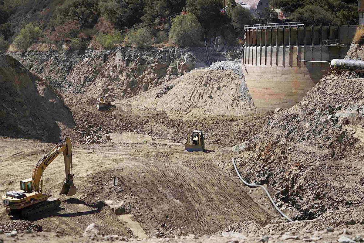 Excavators removing dam