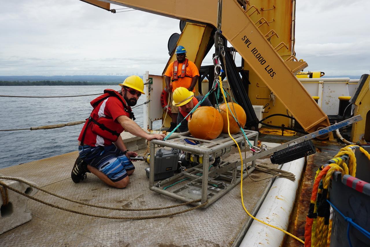 Ship crew and scientists prepare the camera aboard the Sette.