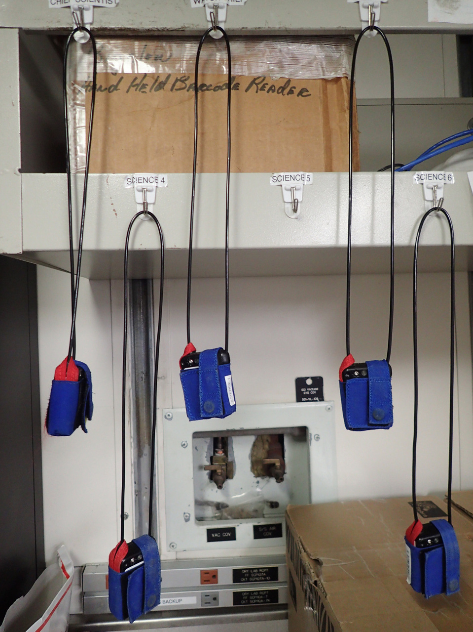 MOB's (man overboard beacons) hanging from beams