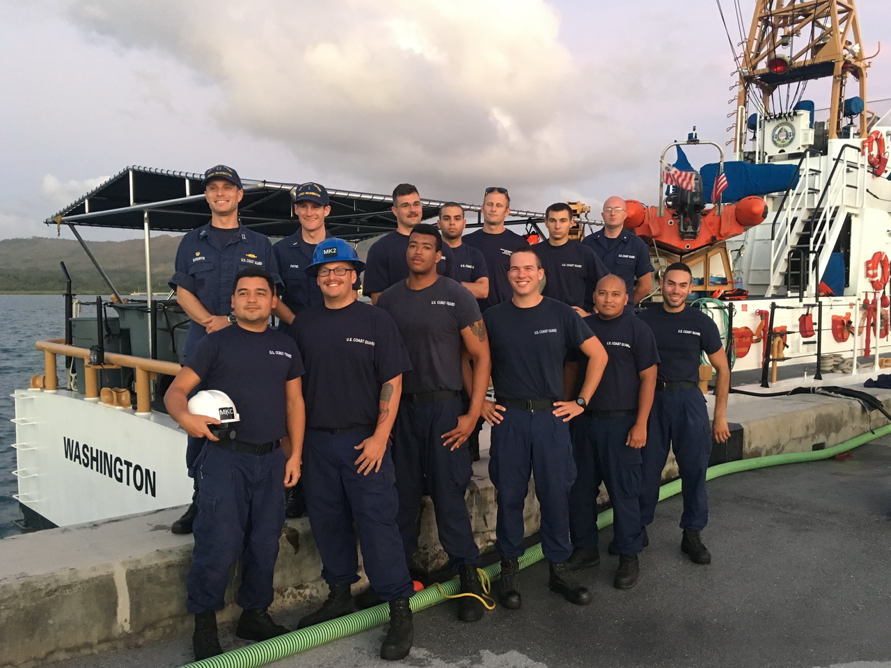 The command and crew of the U.S. Coast Guard Cutter Washington at the dock in Apra Harbor.