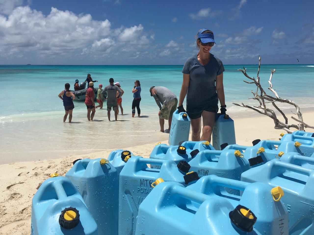 Field scientist offloads water for Lisianski Hawaiian monk seal field camps