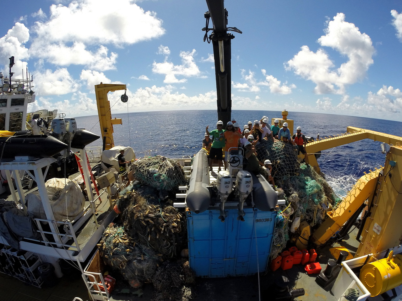 The team perches atop 54 metric tons of derelict fishing gear on the NOAA Ship Sette