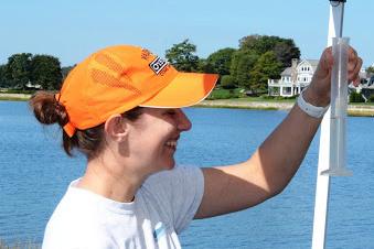 Lisa Guy on a boat conducting fieldwork