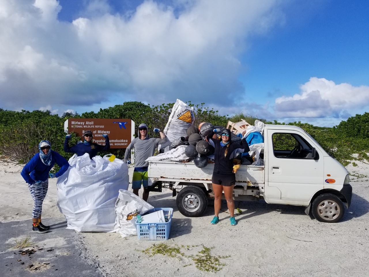 We collect and clear away a truckload of debris from Sand Island on Midway Atoll