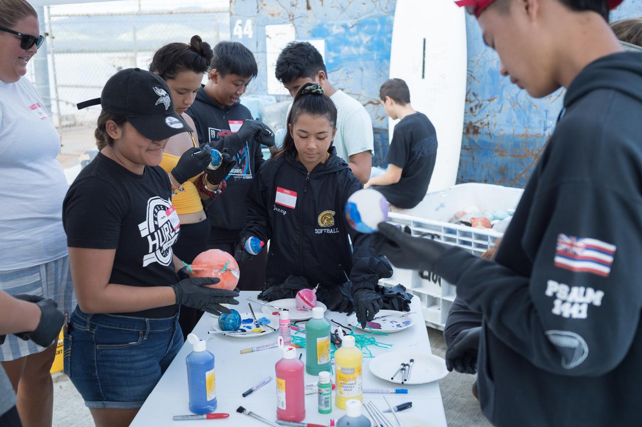 Students repurpose plastic buoys into decorations