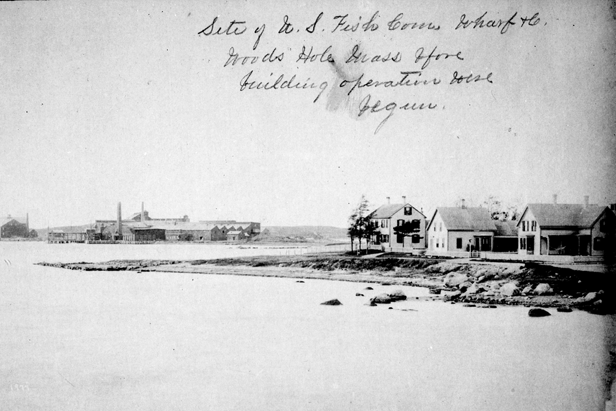 Historic shot of Woods Hole guano works across water