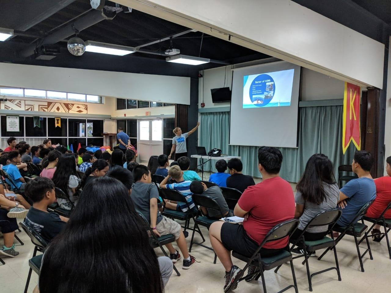 Ali giving a presentation at Camp Maga'lahi 2018.