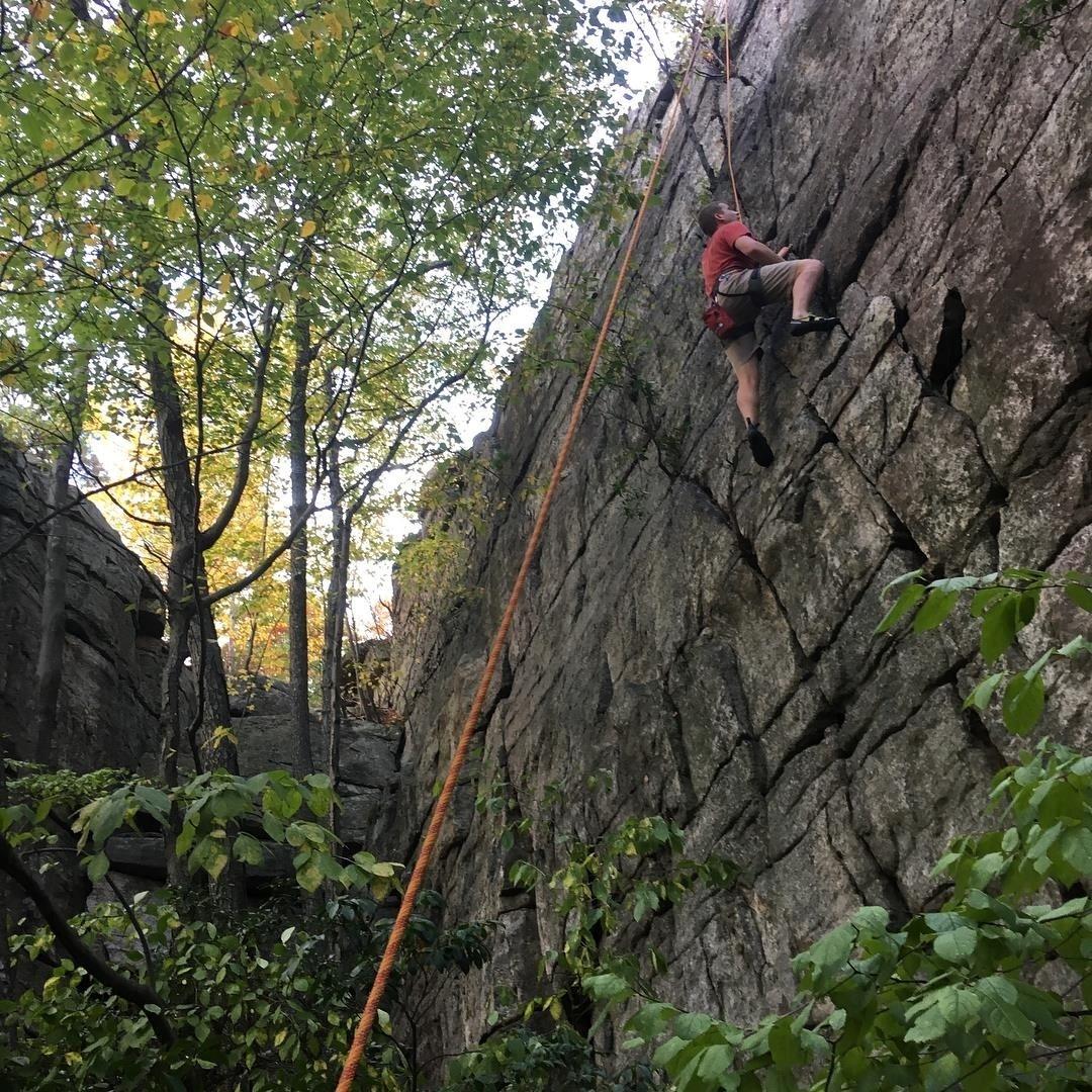 Ben VanDine rock climbing