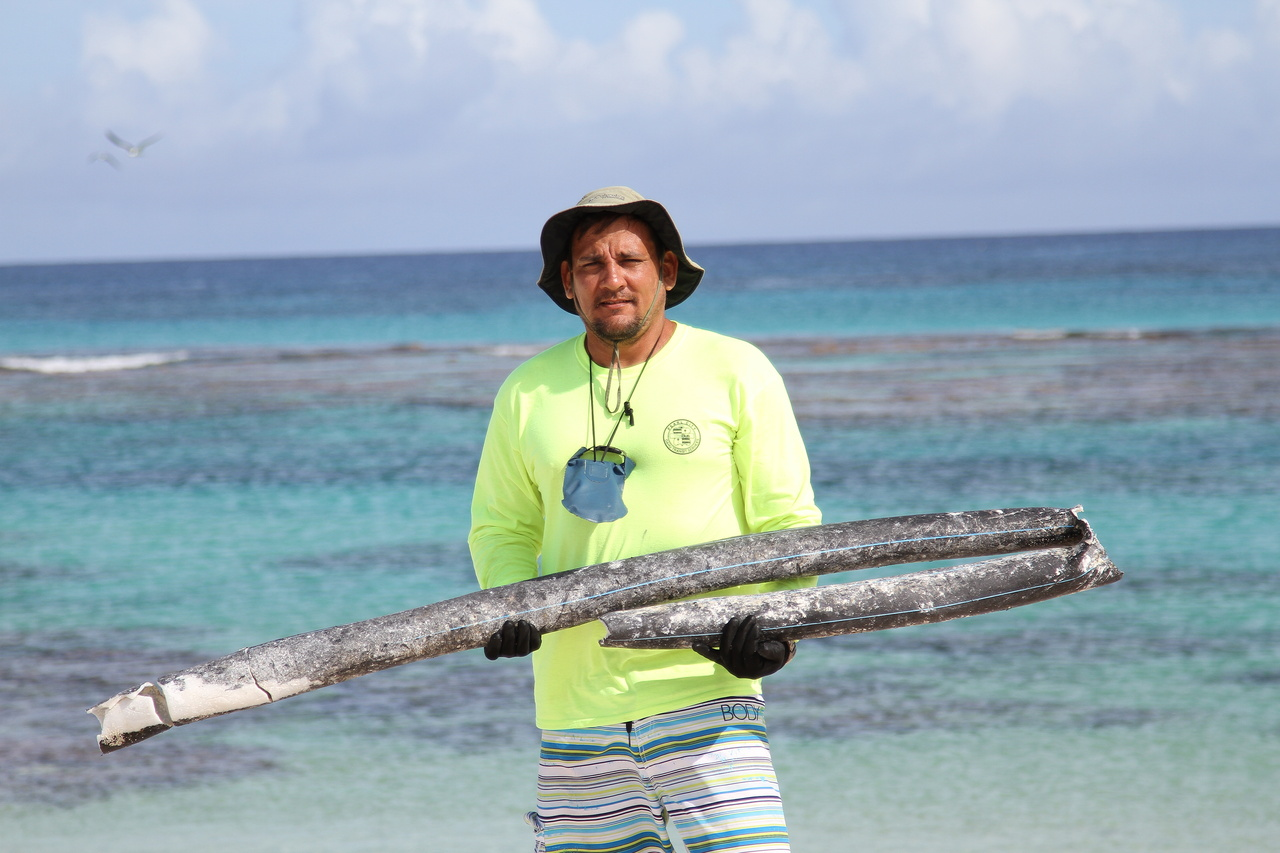 The author cleaning up marine debris at Laysan Island.