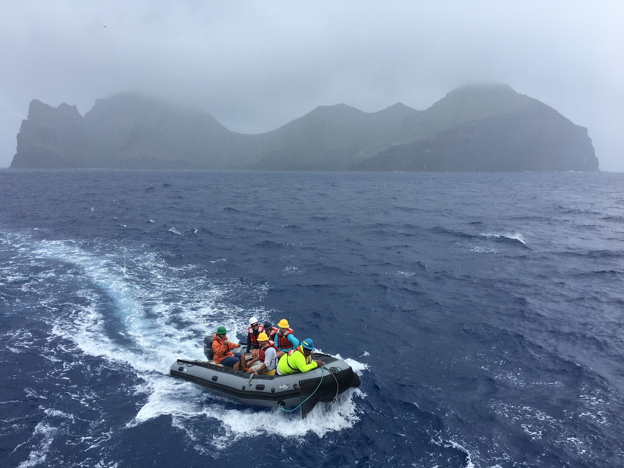 The small boat returns to NOAA Ship Oscar Elton Sette after a rainy butsuccessful day on Nihoa surveying for Hawaiian monk seals