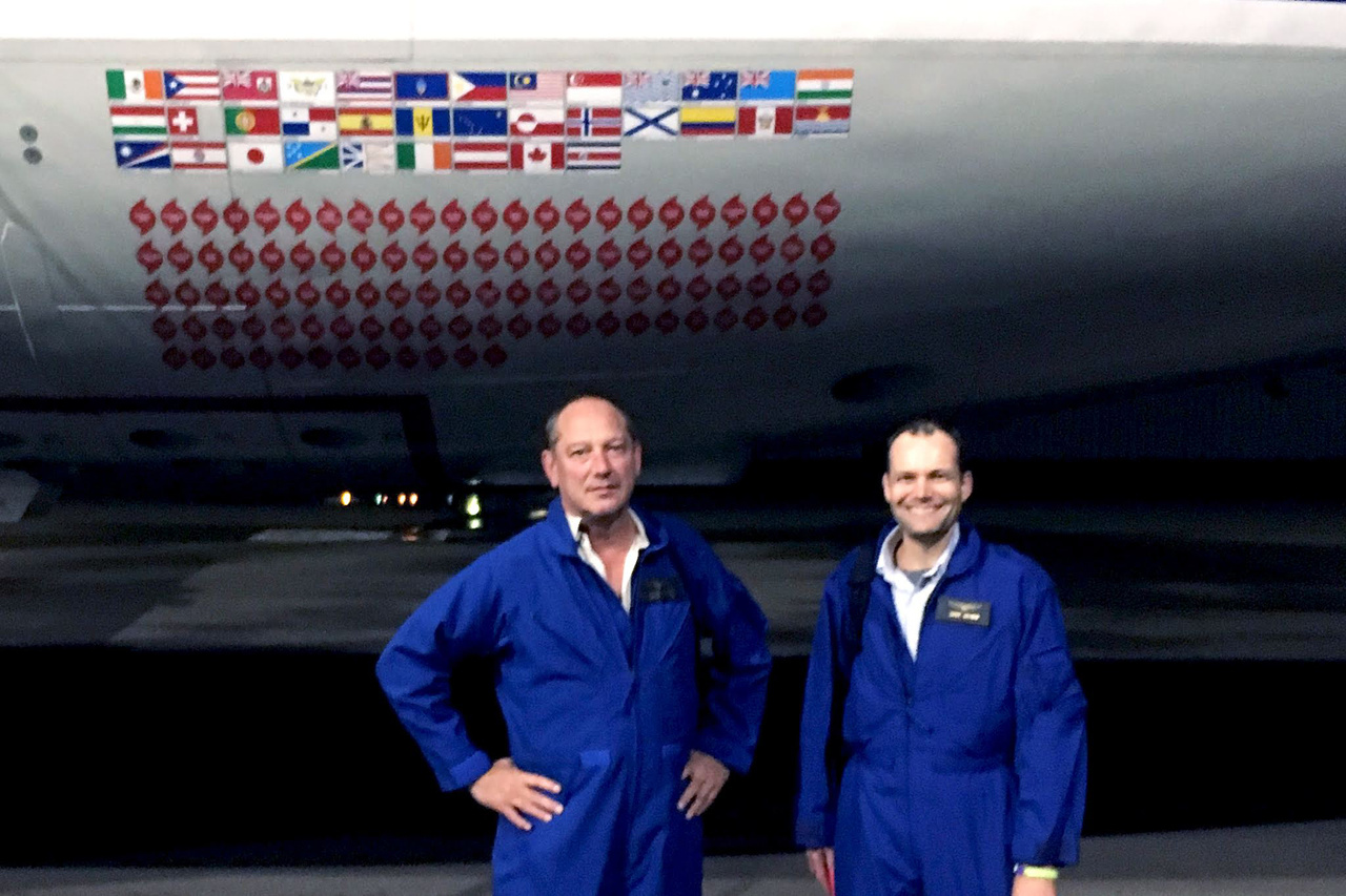Chris Oliver-in-front-NOAA-WP-3D-Orion-Hurricane-Hunter-aircraft.jpg