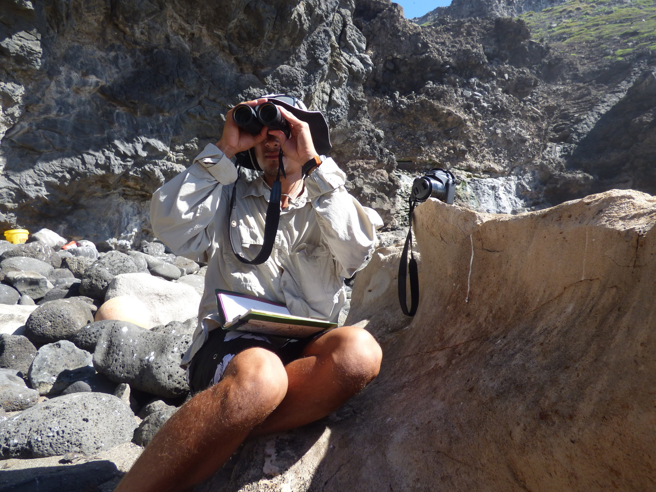 Field Researcher Keelan Barcina searches for monk seals along the shores of Nihoa Island.