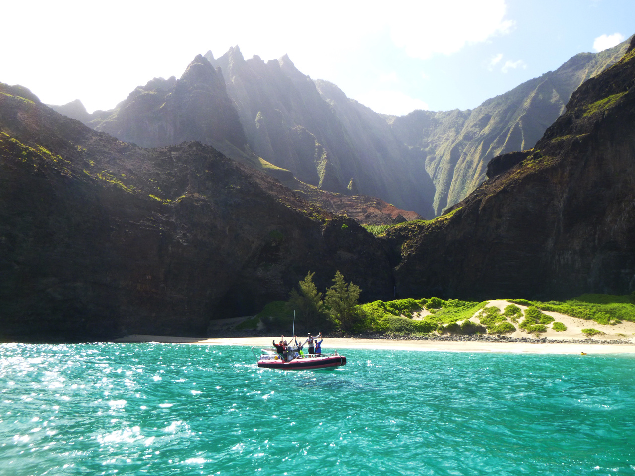 Today was a very special day on the water — we surveyed the reefs around the Nā Pali Coast. We find mostly rocks and boulders below the water's surface. Fishes enjoy the shelter of the boulders, while small coral colonies grow and claim their space on top of the boulders. The Nā Pali Coast can endure some harsh winters with major swells, but it is much calmber in the summer.  Photo: NOAA Fisheries/Mia Lamarind