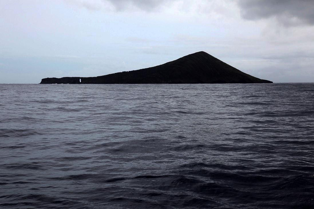 "The ""keyhole"" at Lehua Island on a soggy day forHawaiian monk seal surveys"