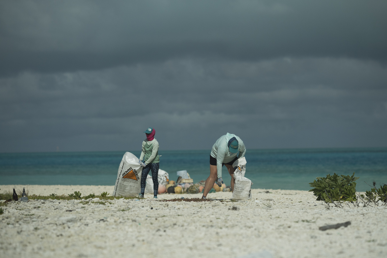Kelly and Rebecca collect marine debris along the shores of Eastern Island