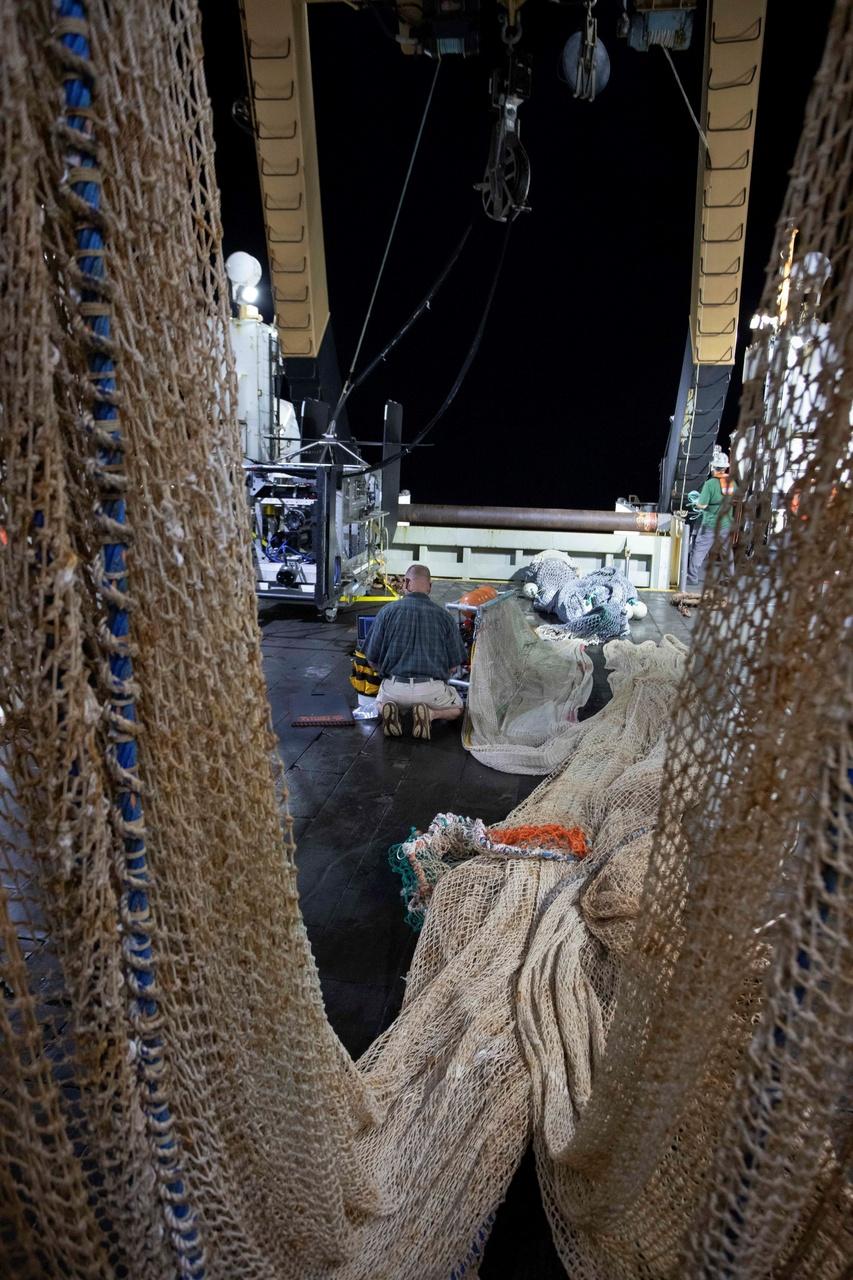 Mike Jeck fixing a trawl net.