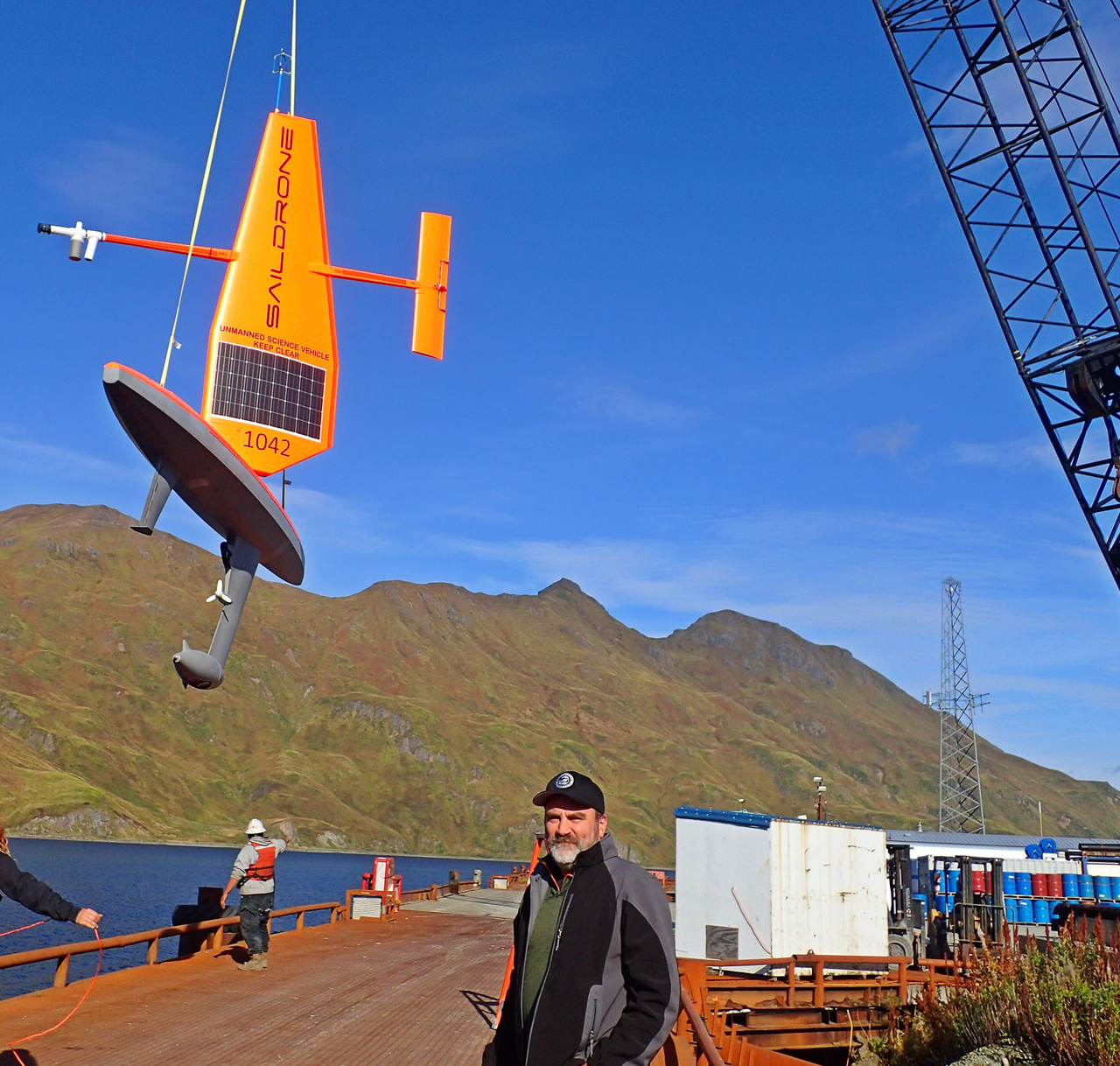 Scott Goodman (Bering Sea Fisheries Research Foundation) watching as a Saildrone is launched in Dutch Harbor, Alaska.