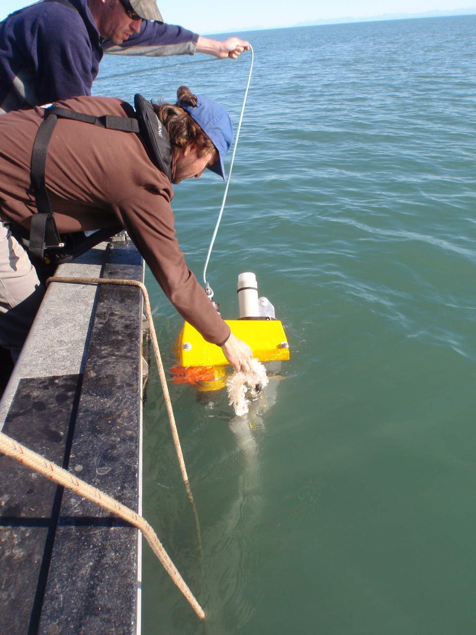 Manuel Castellote and Tom Gage (Alaska Department of Fish and Game) deploy an acoustic mooring in Tuxedni Bay, Cook Inlet, an area recently identified as a possible winter feeding ground for Cook Inlet beluga.