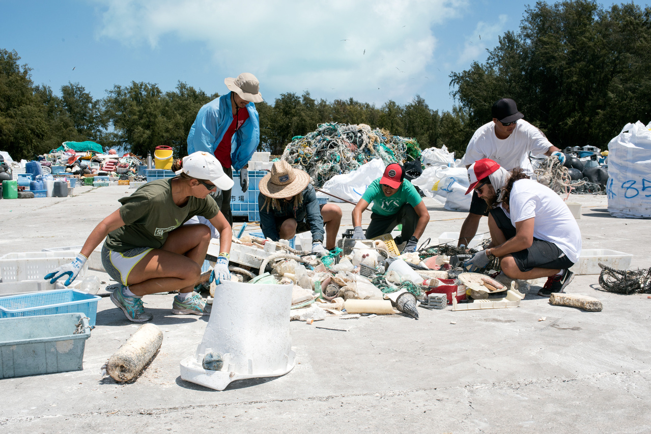 With the help of volunteers from the US Fish and Wildlife Service, the Marine Debris team has completed sorting the derelict fishing gear, plastics and other litter collected over the last eight operational days from the three islands of Midway Atoll National Wildlife Refuge.  Photo: NOAA Fisheries/David Slater