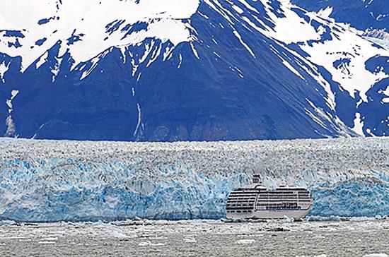Cruise ship sails near Hubbard Glacier in Disenchantment Bay