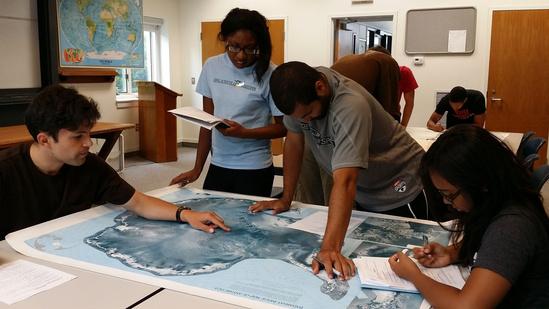 Students observe map of Antarctica