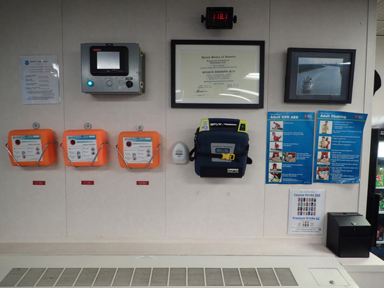 Emergency escape breathing devices, and safety instructions mounted on wall