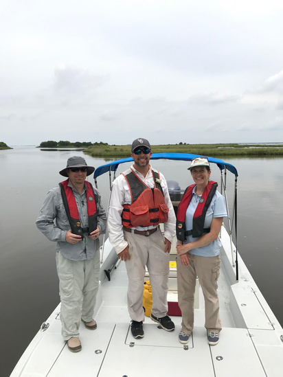 Craig Gothreaux (Habitat Conservation Division), Jason Kroll (NOAA Restoration Center), and Dawn Davis (Habitat Conservation Division) at the West Louisiana Highway One Marsh Creation project site visit..jpg