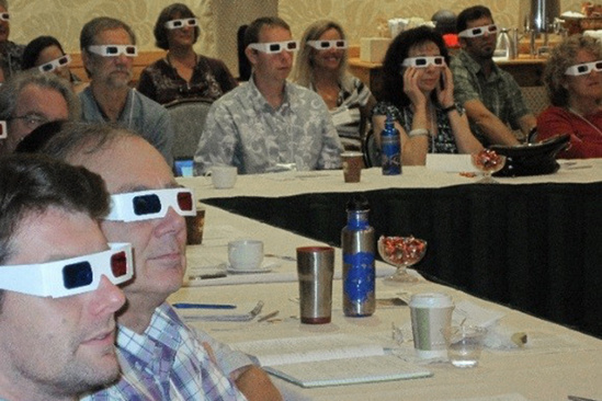 Mariana Trench science workshop; participants wearing 3D glasses.