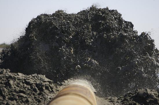 Sediment to restore and create barrier island in Barataria Basin, Louisiana.