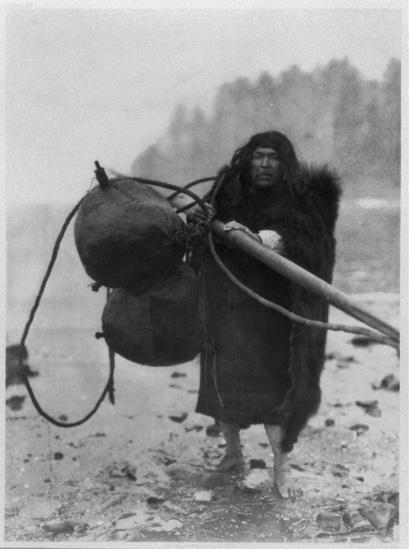 Makah whaler holding a spear