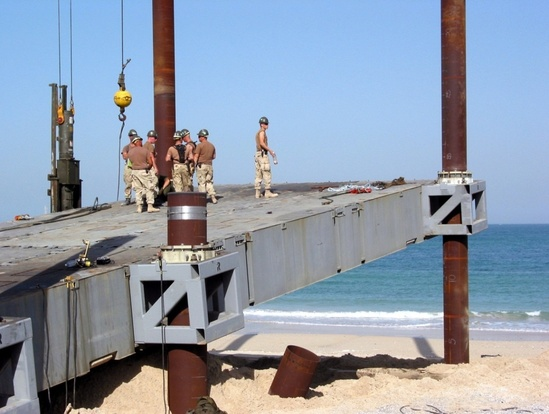 Photo of assembly of pier connection section on beach