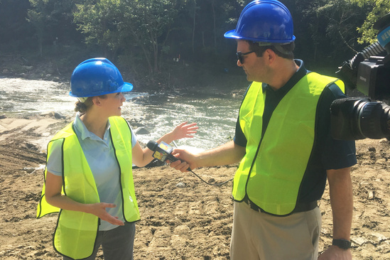 NOAA Habitat staff member, Tisa Shostik speaks with a reporter at the Bloede Dam removal celebra.jpg