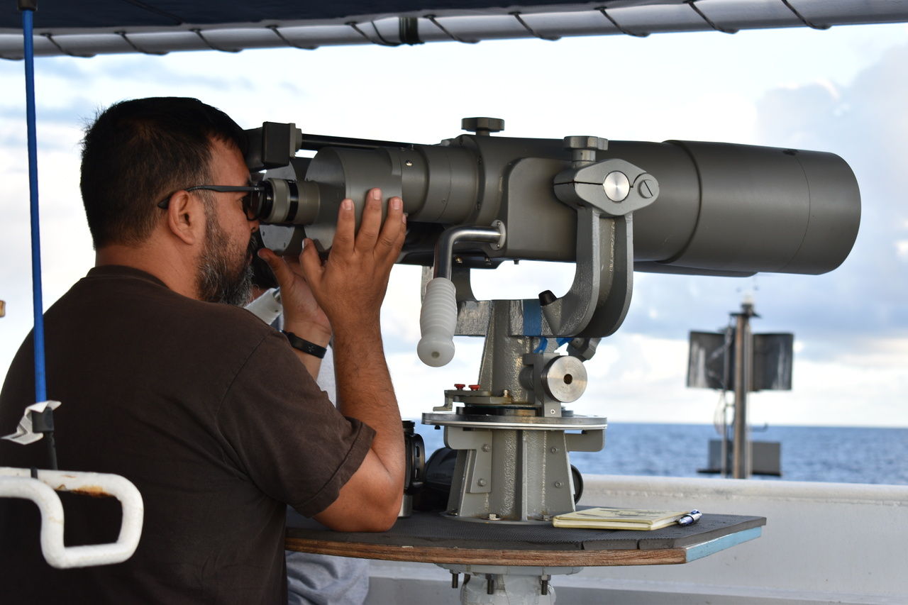 """Visual observers use """"big-eye"""" binoculars to search for cetaceans as far as 7 nmi ahead of the ship."""