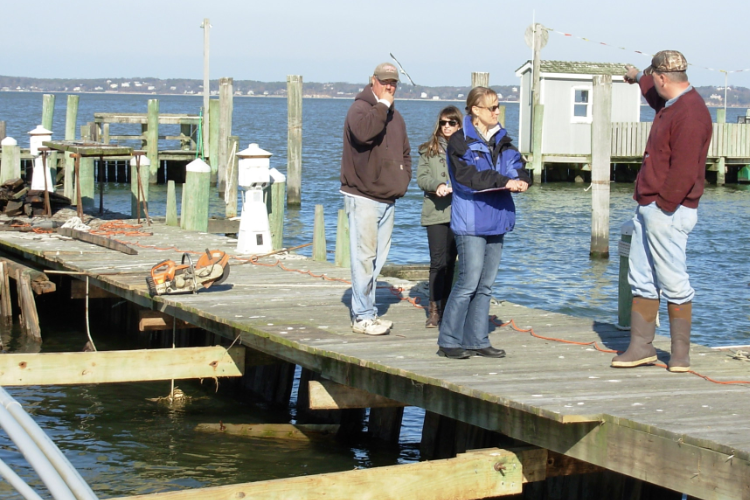 scientists interview fishermen after hurricane sandy by victor vecchio