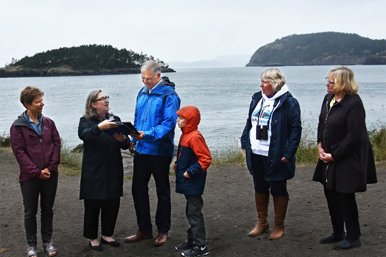 Governor Inslee with a small group of people on a beach