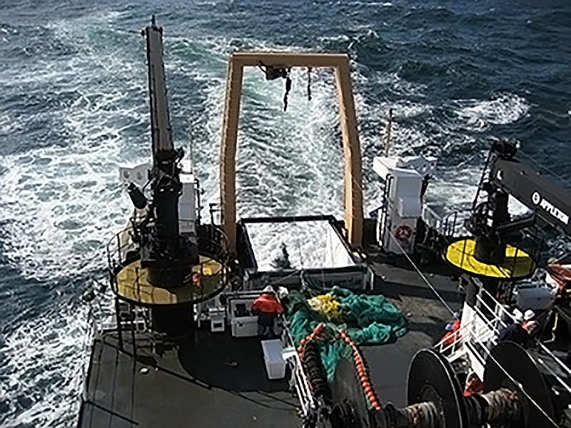 rear deck of a research vessel with net deploying, taken from the second deck of the vessel