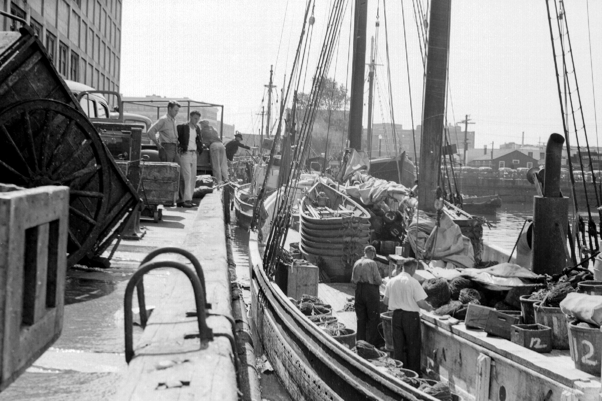 historical photo of fishing vessel docked at the Boston Fish Pier