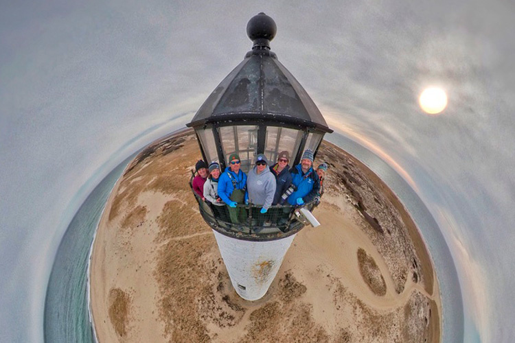 "A ""tinyworld"" photo of the seal sampling team at the top of the lighthouse"