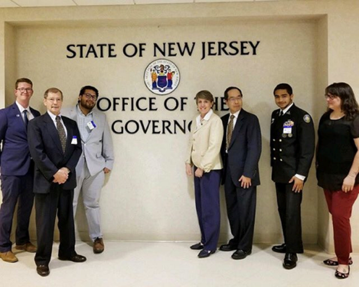 people standing in front of NJ Governor's office