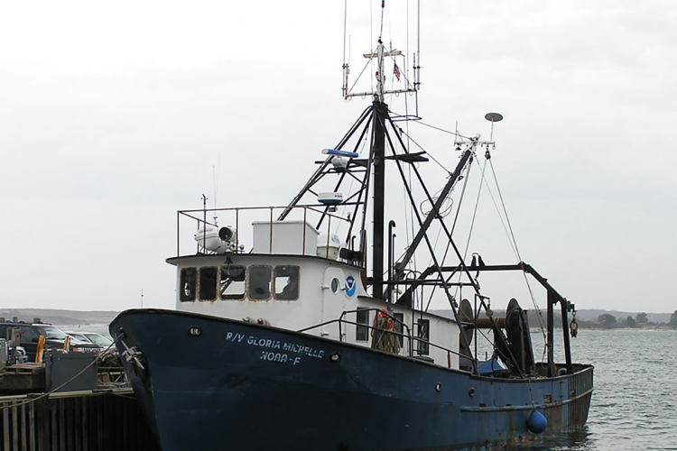 The Gloria Michell tied to dock, trawl gear can be seen.