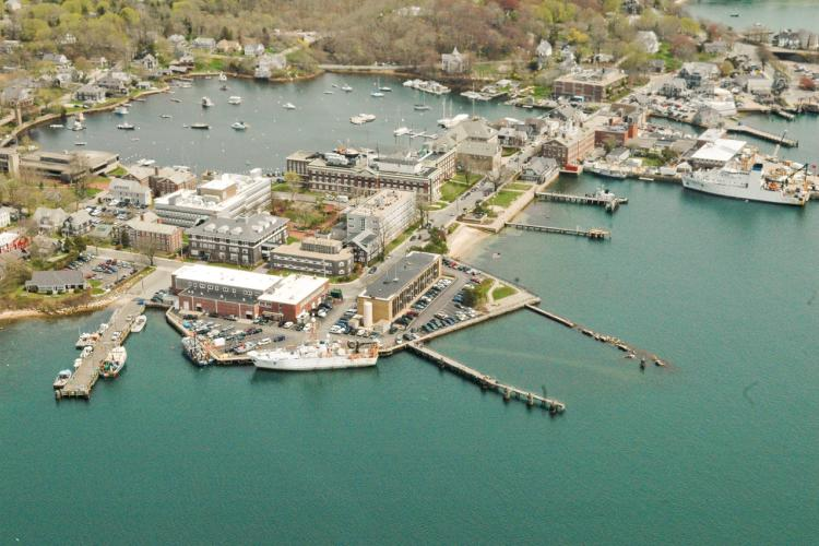 Aerial view of Woods Hole, showing various labs and Eel Pond.